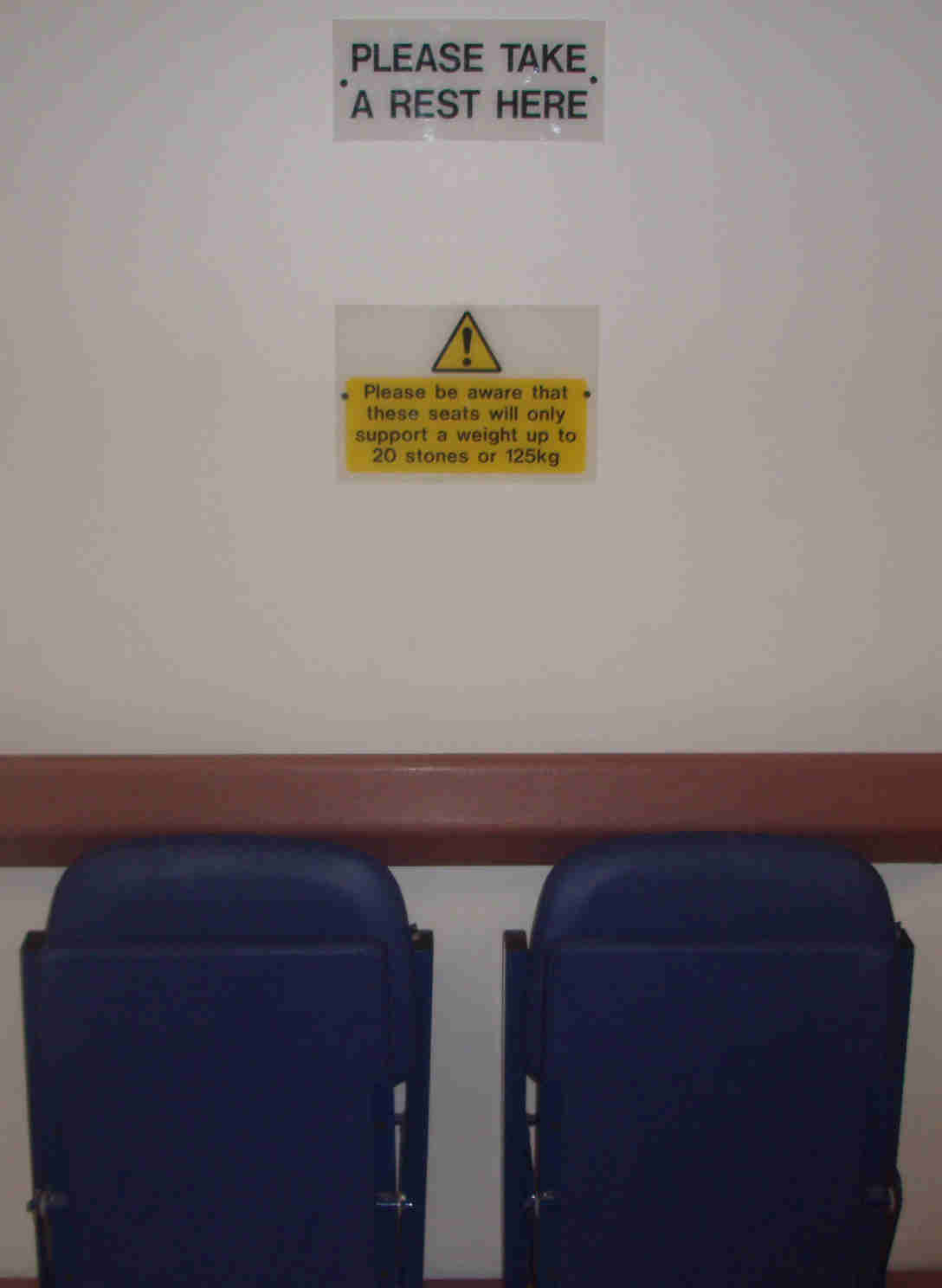 Seats in Hospital Corridor